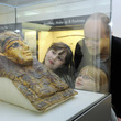 Family looking at Egyptian Funerary mask