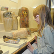 Girl looking at Egyptian artefacts in the Egyptian gallery
