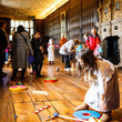 Visitors playing games in the Long Gallery at Aston Hall