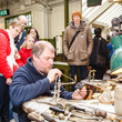 Visitors watching the jewellery making demonstration