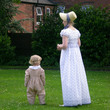 Historical re-enactor and child in the garden of Soho House