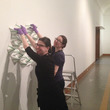 Volunteers helping to install artwork