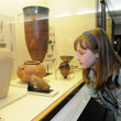 Girl looking at Egyptian artefacts