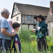 A group on a guided tour at Blakesley Hall