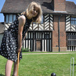 Girl playing croquet outside Blakesley Hall