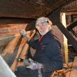 Volunteer Allan repairing the waterwheel