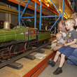 Family looking at train at the Museum Collections Centre