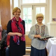 Volunteer Viv on the right, being presented with an award for Volunteer of the Year by Director of Engagement Janine Eason