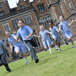 School children running outside Aston Hall