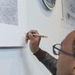 Carl Lavia aka Sketch signing his art work at Birmingham Museum and Art Gallery