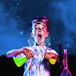 Spooky Science Night - child pouring liquids into beaker to conduct an experiment