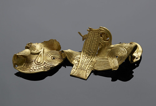Folded gold mount of two eagles grasping a fish
