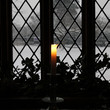 Candle in the window at Blakesley Hall