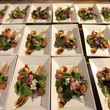 Dishes of salad arranged in rows