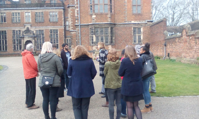 Group on a tour outside of Aston Hall