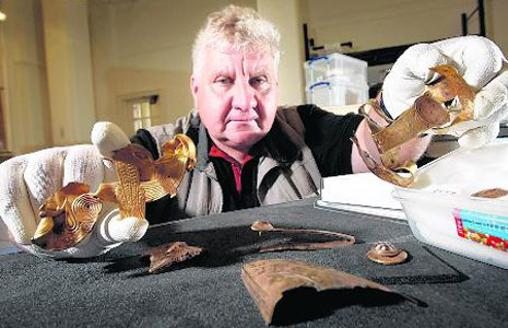 Terry Herbert with some fragments from the Staffordshire Hoard.2