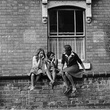 Young girls sitting on a wall in Charleville Road, Handsworth, 1991.