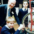 Sir Clive Sinclair meets young inventors in Bristol (England) in 1992. Picture taken by Adrian Pingstone and released to the public domain.