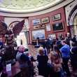 Preview event, people standing around Jacob Epstein's Lucifer in the Round Room at Birmingham Museum and Art Gallery