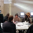 Donald Rodney community consultation. A group of people discussing the Donald Rodney artworks.