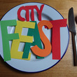 City Feast in paper letters on plate