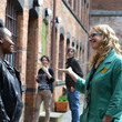 Visitor being greeted by a member of staff in the courtyard of the Coffin Works © the Coffin Works