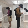 Patrons' experience virtual reality in the Thresholds exhibition at the Museum & Art Gallery