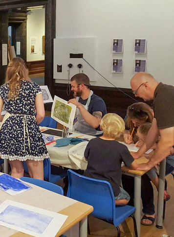 Visitors taking part in the mono-print workshop