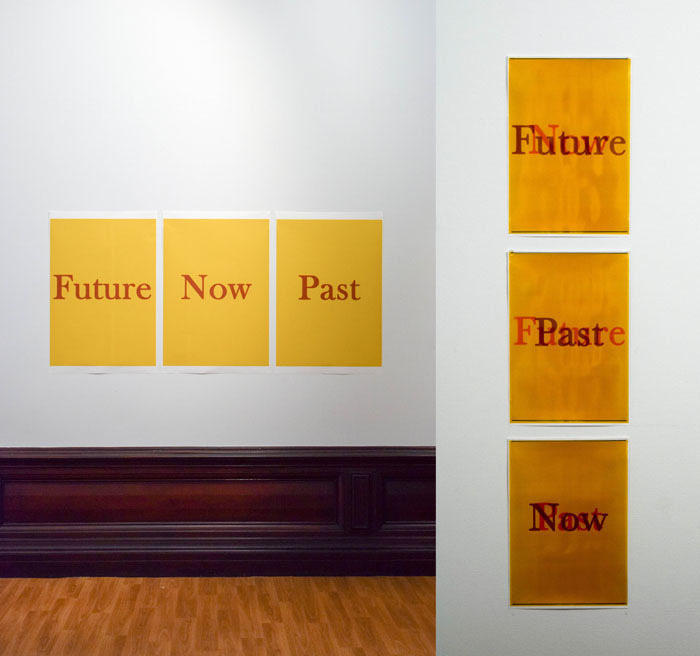 Signs on wall saying Future / Now / Past