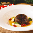 Christmas pudding with cranberries and brandy sauce