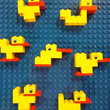 Lego ducks on a wall
