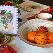 Table with pomander, card and Christmas cracker