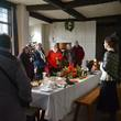 Visitors in the Great Hall at Blakesley Hall at Christmas