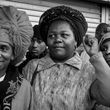 Three Rastafarian women protest with the crowd at the site of an alleged rape in Perry Barr, 2005 © Vanley Burke