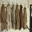 Work coats hanging on a peg as they were left in 1981 at Smith & Pepper jewellery manufacturing firm