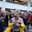 Ginny Lemon performing at Birmingham New Street station for the Coming Out launch
