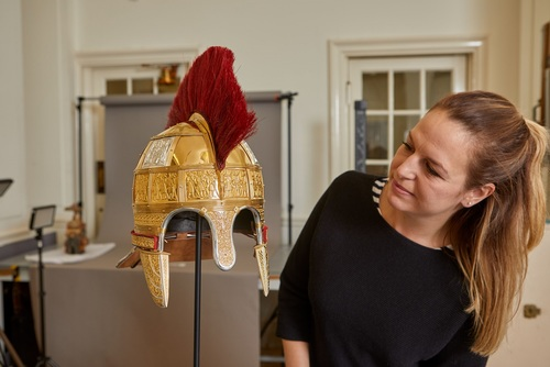 Birmingham Museums Trust Conservator Lizzie Miller with the reconstructed Staffordshire Hoard helmet
