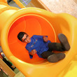 A child coming out of the slide in MiniBrum