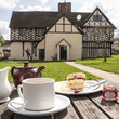 Tea and scone in the garden at Blakesley Hall