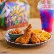 Chicken strips, fries, beans and slushie