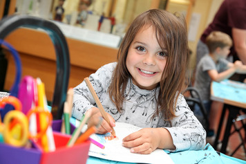 Child taking part in a craft activity