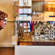Visitor looking at the model of Aston Hall in the gift shop