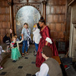 Group of children and families on a Cinderella tour Aston Hall