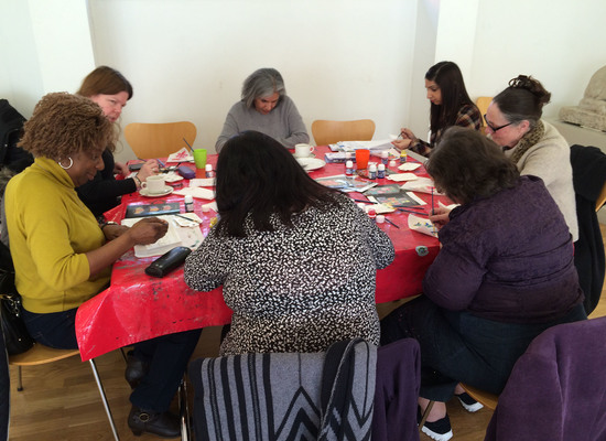 Group of participants taking part in an art activity (part of the Creative Carers Programme)