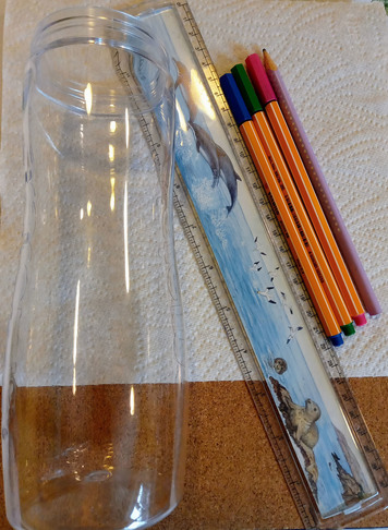 Equipment for the a paper rainbow experiment, includes: coffee filter paper or a sheet or two of kitchen roll, 3 coloured felt pens, a clear container,  pencil, drop of water