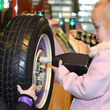 Child fixing a wheel onto a Mini in the We Made It gallery